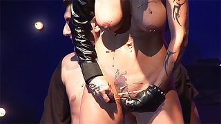 extreme bizarre fetish show on public stage