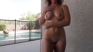 Beautiful blonde mom walks around the house revealing her d